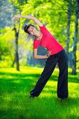 pic of stretch  - Stretching woman in outdoor sport exercise - JPG