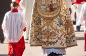 stock photo of priest  - altar boy and priest during a religious ceremony - JPG