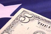 picture of american money  - american dollars on american flag - JPG