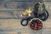 stock photo of eastern culture  - Dates arabian lantern and rosary - JPG