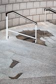 picture of bannister  - rain puddle on the stairs - JPG