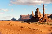 foto of indian totem pole  - Totem pole rocks and sand dunes in Monument valley tribal park - JPG