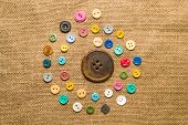 stock photo of hasp  - Many old collor buttons scattered on the old cloth - JPG