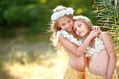stock photo of sisters  - Portrait Of Twin Sisters In Tropical Style - JPG