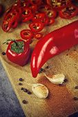 pic of chili peppers  - Red Hot Chili Pepper Spice and Organic Garlic on Wooden Kitchen Plate as Hot Food Ingredients for Spicy Piquant Cuisine - JPG