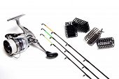 picture of fishing rod  - Fishing feeder and reel with accessories on white background - JPG