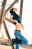 pic of rebel  - young rebel woman in blue jeans - JPG