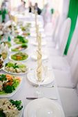 stock photo of banquet  - Banquet wedding table setting on evening reception - JPG