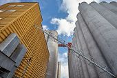 pic of silo  - Factory exterior with big concrete grain silos and manufacturing building in Finland - JPG