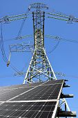 foto of electricity pylon  - Solar energy panels with electricity pylon - JPG