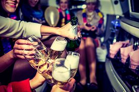 stock photo of champagne color  - Girls in limo at hen-party with champagne ** Note: Shallow depth of field - JPG