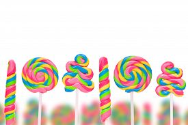 foto of lolli  - Fantasy sweet candy land with lollies isolated on white background - JPG