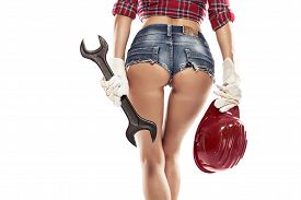 stock photo of bum  - Nice sexy woman mechanic showing bum buttock and holding wrench isolated over white background - JPG