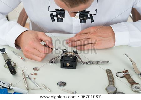 Man Repairing Wrist Watch