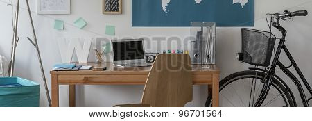 Bike Standing Beside Wooden Desk