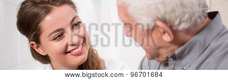 Girl Smiling To Elder Man