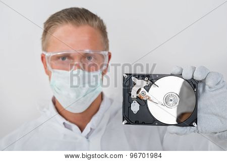 Technician Showing Hard Drive