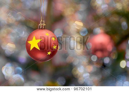 tree ball with china flag on Christmas tree