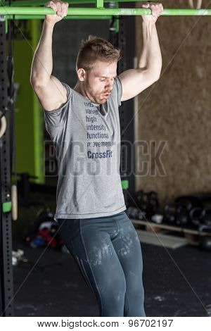 Muscular Man Doing Pull-ups