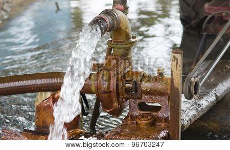 Rusty Pump Engine In Farm
