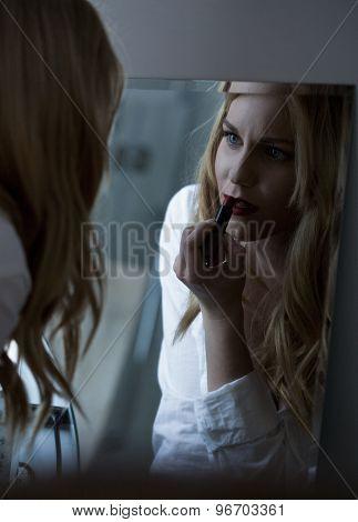 Beauty Woman Applying Red Lipstick