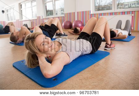 Woman Training Her Stomach Muscles