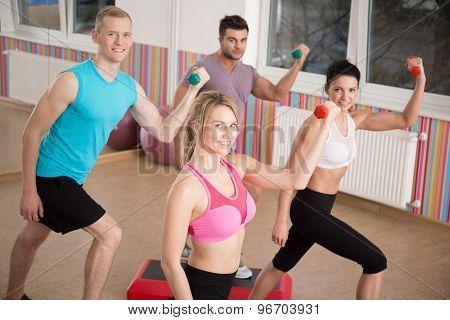 Athletes Training With Dumbbell