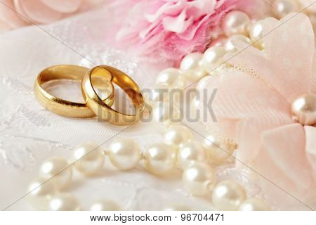 wedding decoration with flowers and wedding rings