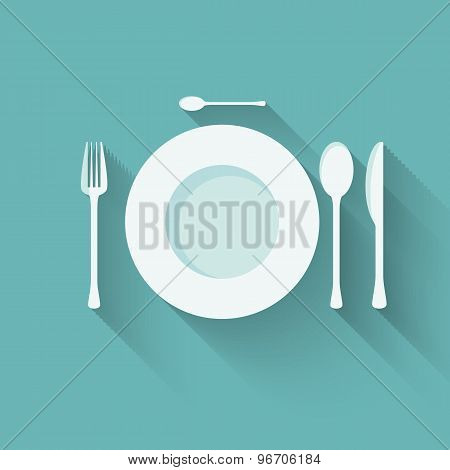 flat plate and cutlery with long shadows