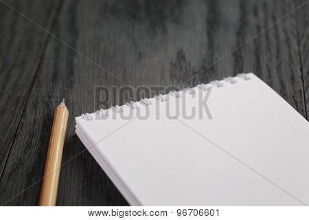 closeup photo of open empty notepad with pencil