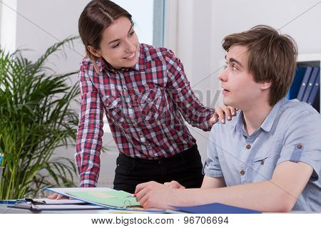 Young Woman Flirting With Co-worker