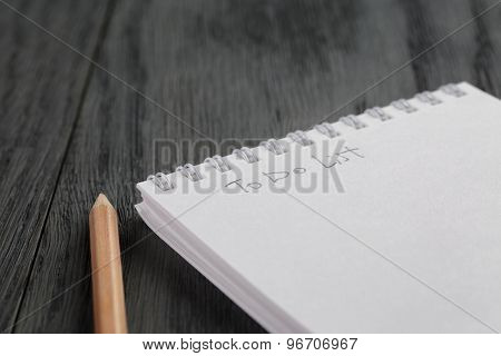 closeup photo of open empty notepad with to do list phrase