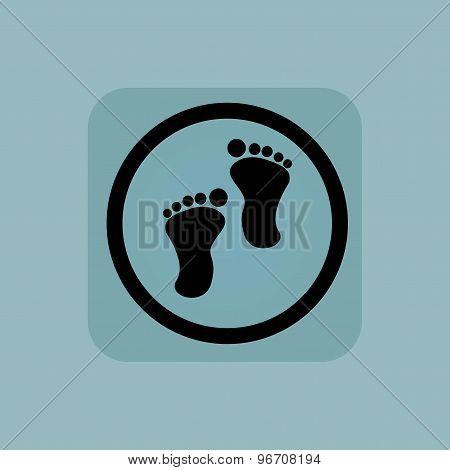 Pale blue footprint sign