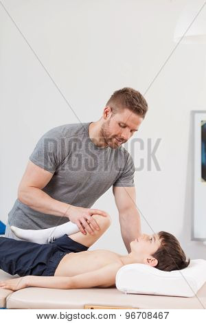 Physiotherapist Working With Little Boy