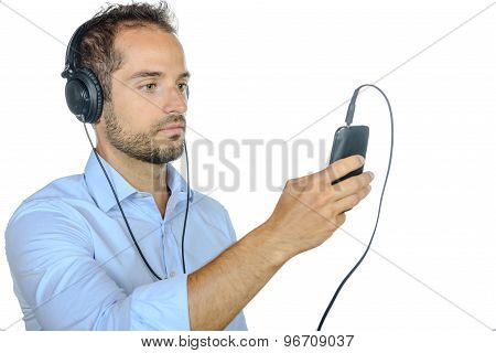 Young Man Listening To Music With His Phone