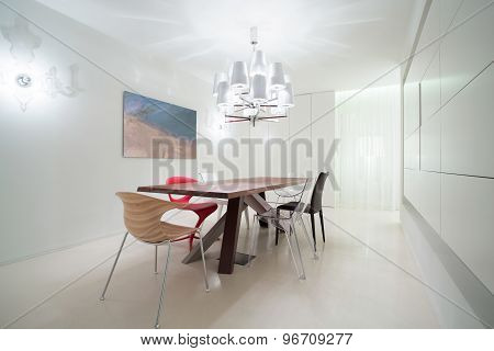 Various Chairs In Dining Room