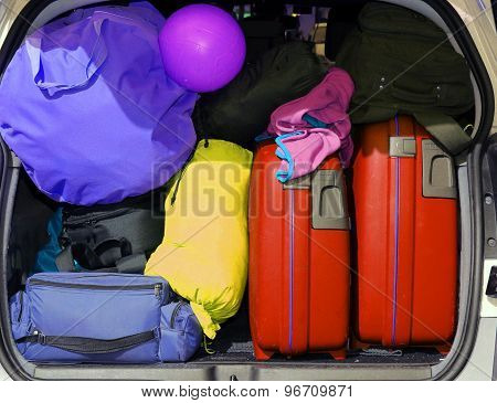 Suitcases And Luggage In The Trunk While Traveling In Family