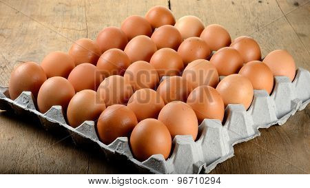 Egg In Packet On Wooden Background