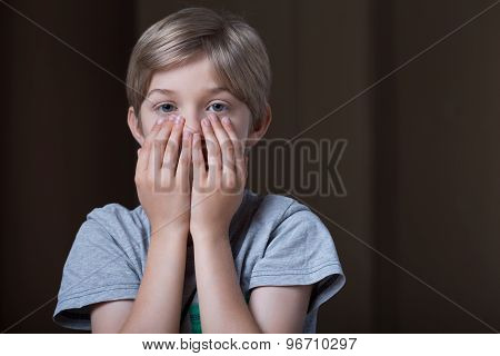 Boy Hiding Face Behind Hands