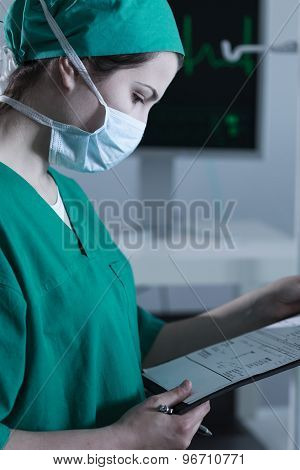 Female Surgeon In Scrubs