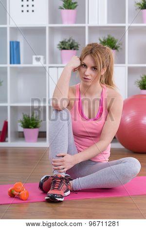 Sitting On Exercise Floor Mat