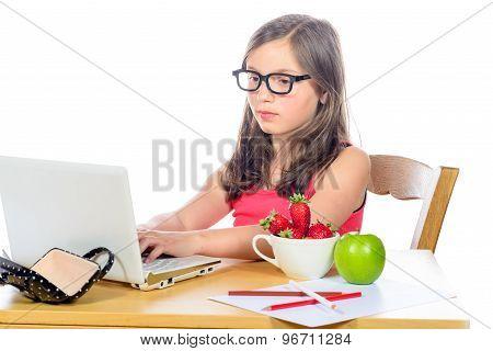 A Little Girl Doing Her Homework On Her Computer