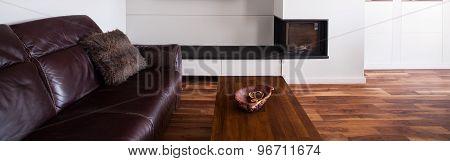 Leather Sofa On Wooden Floor