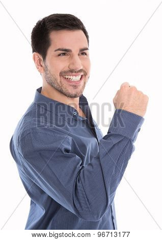 Proud and successful young business man making fist gesture isolated over white.