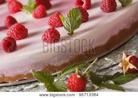 Raspberry Cheesecake With Mint Macro On The Table. Horizontal