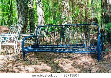 Old Iron Sofa Frame In Woods