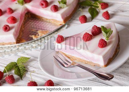 Cutting Piece Delicate Cheesecake With Raspberries Closeup. Horizontal