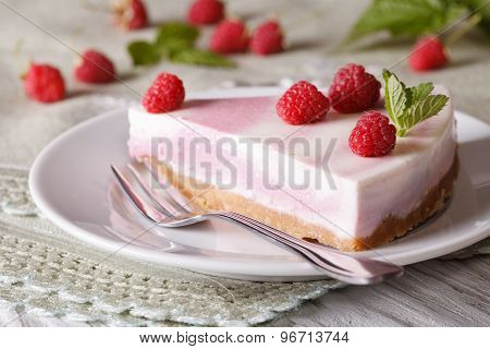 Slice Of Cheesecake With Raspberries And Mint Close-up. Horizontal