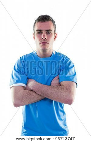 Portrait of a serious rugby player with arms crossed