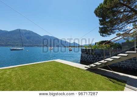 Architecture outdoor terrace overlooking the lake, with garden